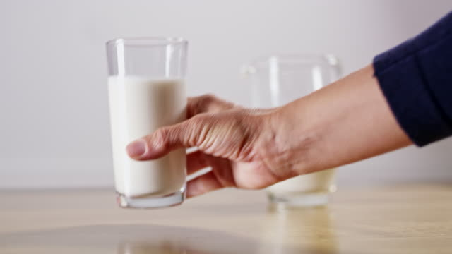 ms hand picking up a glass of milk - drink stock videos & royalty-free footage