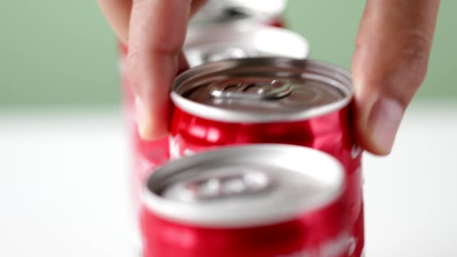 hand picks a can of soft drink in red container - ready meal stock videos & royalty-free footage