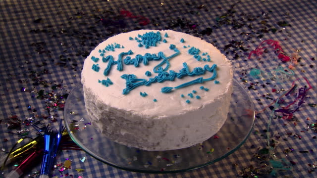 cu, hand placing candle on birthday cake  - birthday candle stock videos & royalty-free footage