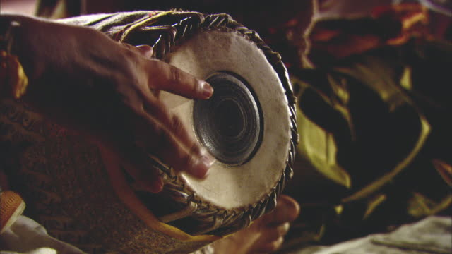 CU Hand playing traditional Indian drum / India