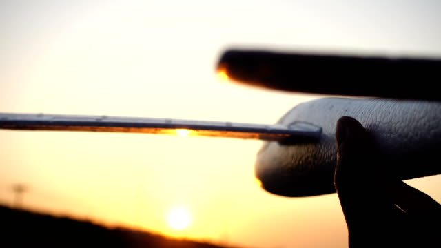 Hand plays with the airplane