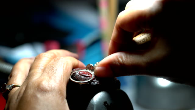 hand polishing gold jewelry ring jeweler. production and making manufacturing - ring stock videos and b-roll footage