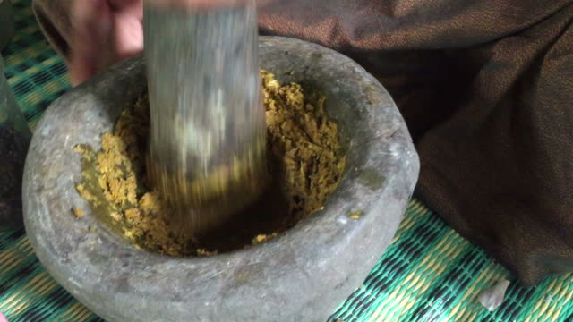 hand pounding fresh spices curry paste - grinding stock videos and b-roll footage