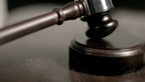 hand pounding gavel in super slow motion - law stock-videos und b-roll-filmmaterial