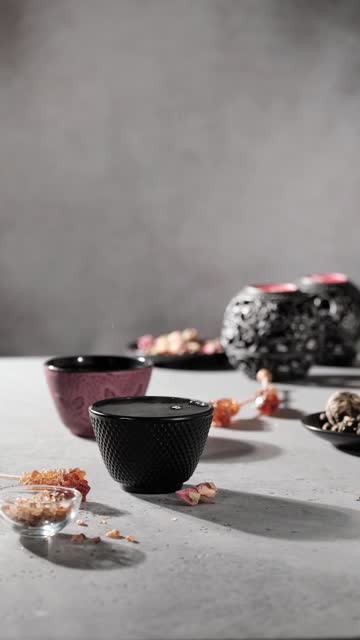 hand pouring cup of green tea from black cast iron teapot into pink cup. lot of steam. vertical format fullhd footage - full hd format stock videos & royalty-free footage
