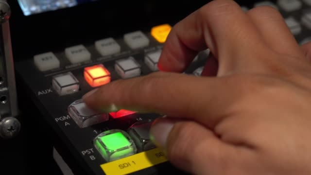 hand press on video switcher, broadcast television. - broadcasting stock videos & royalty-free footage