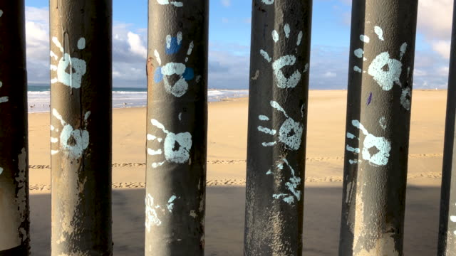 hand prints are placed on usmexico border fence on the beach on september 28 2019 in tijuana mexico the artwork is part of the playas of tijuana... - deported stock videos & royalty-free footage