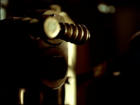 vídeos de stock e filmes b-roll de hand pulling lever, south africa - puxar