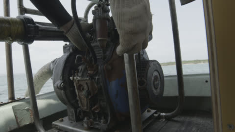 vídeos y material grabado en eventos de stock de hand pulls starter cord to start pump. japan. - motor eléctrico