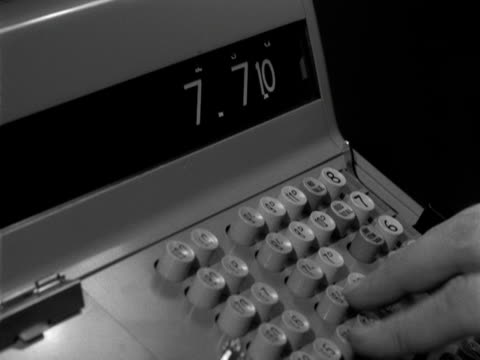 a hand pushes the keys and levers on a cash register 1963 - cash register stock videos and b-roll footage