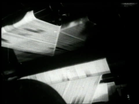 1948 montage hand pushing button and starting newspaper presses running / new york city, new york, united states - 1948 stock-videos und b-roll-filmmaterial