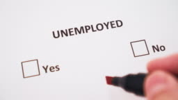 A hand puts a check mark next to YES on white paper under the word UNEMPLOYED in the checklist
