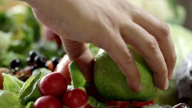 hand puts an apple - human limb stock videos & royalty-free footage