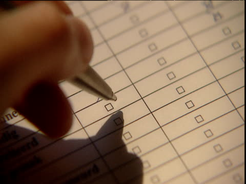 hand puts crosses in boxes on questionnaire - ballpoint pen stock videos & royalty-free footage