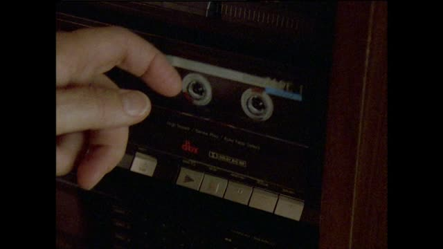 cu of hand putting cassette into tape deck and playing - 1994 stock-videos und b-roll-filmmaterial