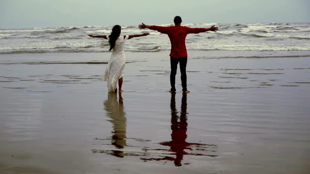 hand raised on summer beach - human limb stock videos & royalty-free footage