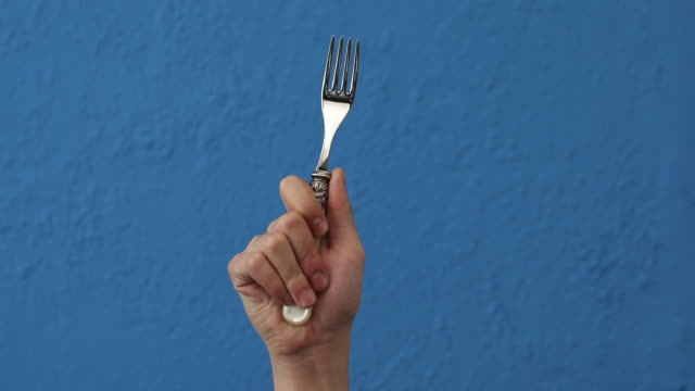 CU Hand Raising with grabbed Fork / Seoul, South Korea