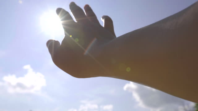 hand reach to the sun - god stock videos & royalty-free footage