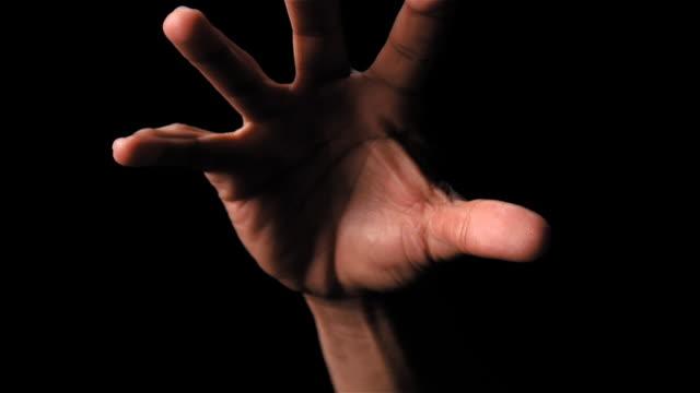Hand reaching down