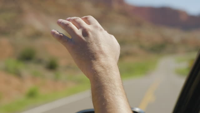 hand reaching out the car window to feel the air - reaching stock videos & royalty-free footage