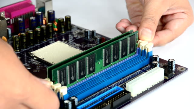 Hand removing Random Access Memory (RAM) into Motherboard