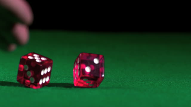 hand rolling pink dice - dice stock videos & royalty-free footage