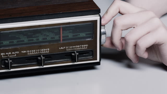 a hand rotates the knob on a retro radio. - knob stock videos and b-roll footage