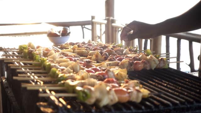 hand rotating skewer barbecue - skewer stock videos & royalty-free footage