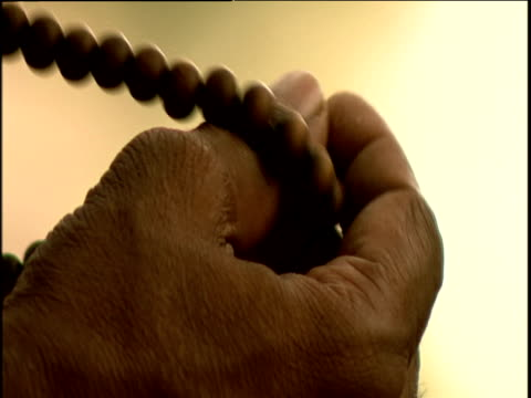 hand rubs prayer beads - prayer beads stock videos & royalty-free footage