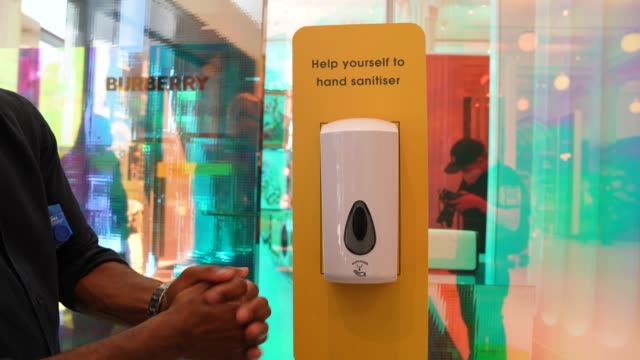 hand sanitiser dispenser at the entrance of selfridges on oxford street on june 15, 2020 in london, england the british government have relaxed... - hand stock videos & royalty-free footage
