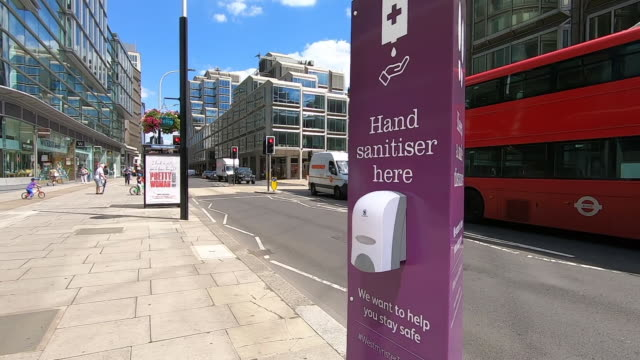hand sanitiser on a london street - street stock videos & royalty-free footage