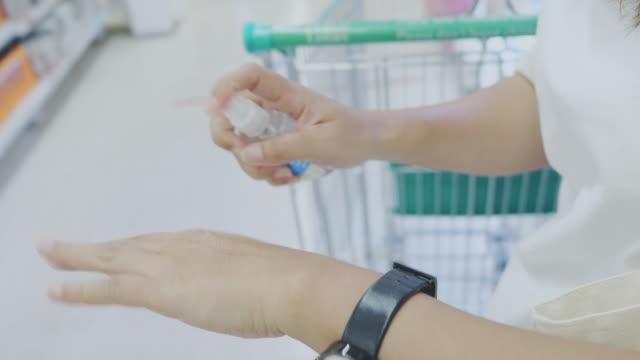 hand sanitizer in market. - spraying stock videos & royalty-free footage