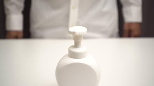 hand sanitizer soap foam clean hands hygiene prevention of corona virus outbreak. man using bottle of antibacterial sanitiser soap. covid-19 - soap dispenser stock videos & royalty-free footage