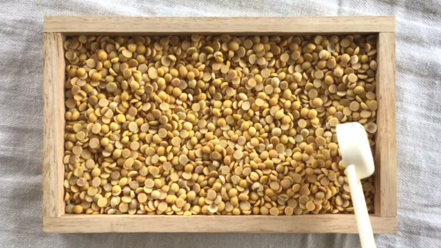 hand scooping soybeans in a measurement spoon - dried food stock videos & royalty-free footage