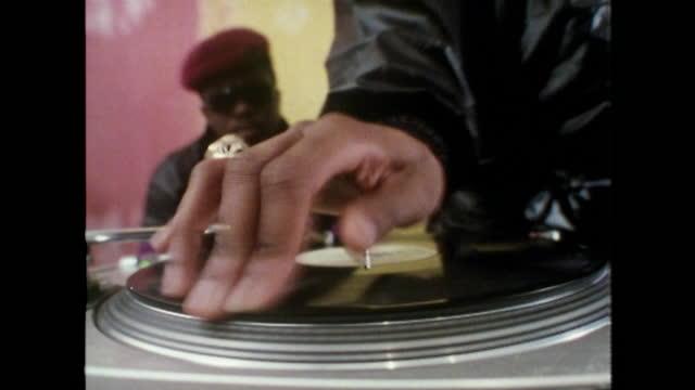 cu hand scratching vinyl record on turntable; 1989 - medium shot stock videos & royalty-free footage