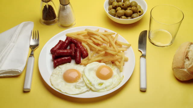 cu hand serving chorizo, eggs & chips with drink - chorizo stock videos & royalty-free footage