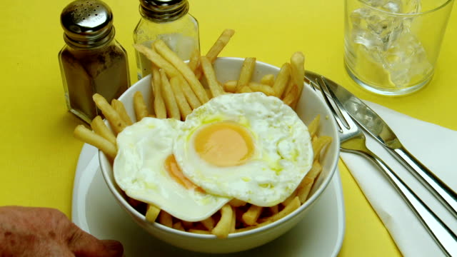 CU Hand serving Fried Eggs & Chips