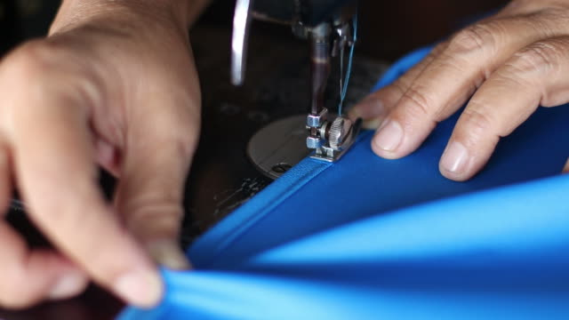 hand sewn blue fabric with old sewing machines. - cucire video stock e b–roll