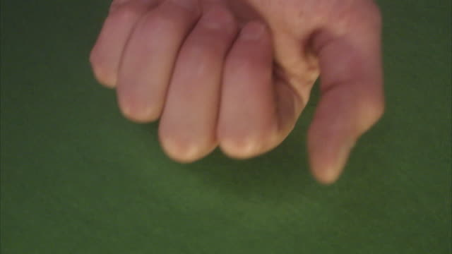 A hand showing the result from a game of dice.