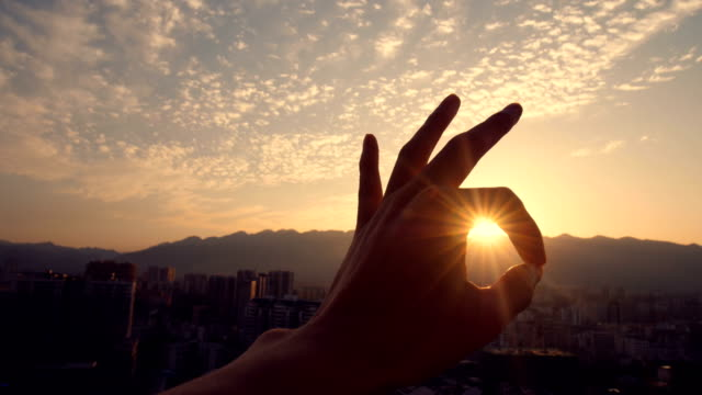 ok hand sign against sunlight - hand sign stock videos & royalty-free footage