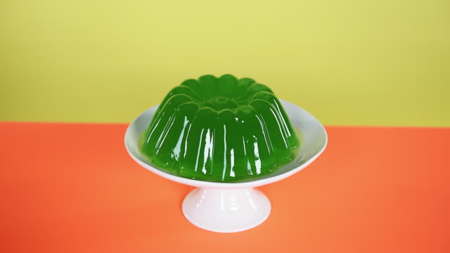 hand smacking wobbling green jelly - gelatin stock videos and b-roll footage
