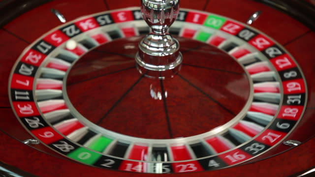 hand spinning ball around roulette wheel - at the edge of stock videos & royalty-free footage