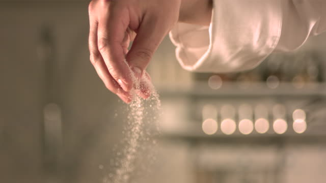 Hand sprinkling sugar