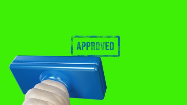 hand stamping approved on green screen - representing stock videos & royalty-free footage