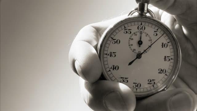 hand starting up a stopwatch. - menschlicher finger stock-videos und b-roll-filmmaterial