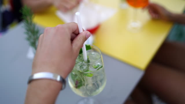hand stirring cocktail at outdoor bar - cocktail stock videos & royalty-free footage