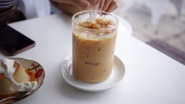hand stirring tasty ice coffee. - mocha stock videos and b-roll footage