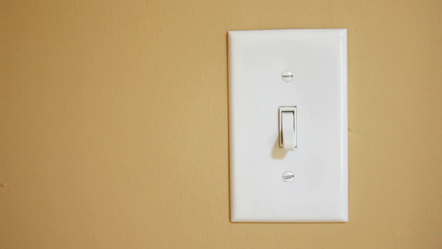 hand switching light switch off and on - light switch stock videos & royalty-free footage