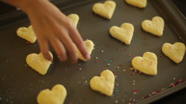 cu hand taking a cookie from baking tray - baking tray stock videos & royalty-free footage