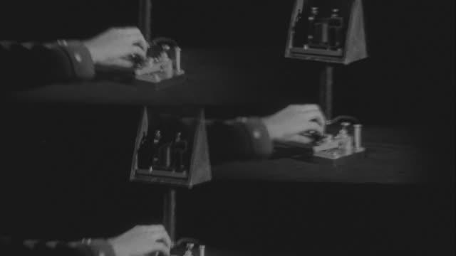 ms hand tapping telegraph code sender - telegraf stock-videos und b-roll-filmmaterial